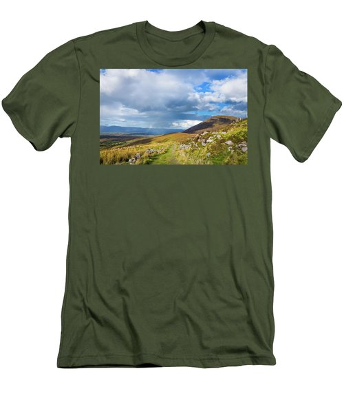 Men's T-Shirt (Slim Fit) featuring the photograph Raining Down And Sunshine With Rainbow On The Countryside In Ire by Semmick Photo