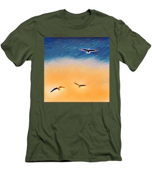 Seagulls Flying In The Burning Sky Men's T-Shirt (Slim Fit) by Paul Mc Namara