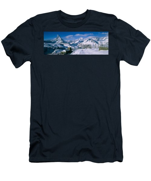 Group Of People Skiing Near A Mountain Men's T-Shirt (Athletic Fit)