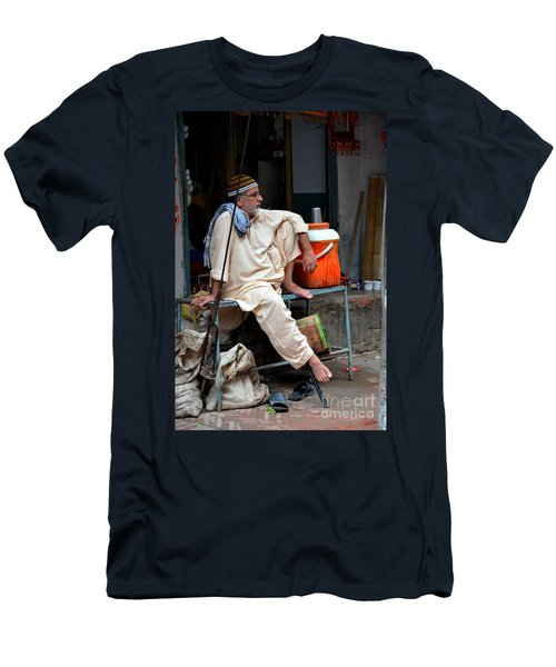 Man Sits And Relaxes In Lahore Walled City Pakistan Men's T-Shirt (Athletic Fit)