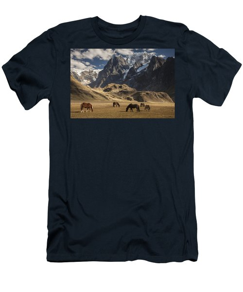 Men's T-Shirt (Athletic Fit) featuring the photograph Horses Grazing Under Siula Grande by Colin Monteath