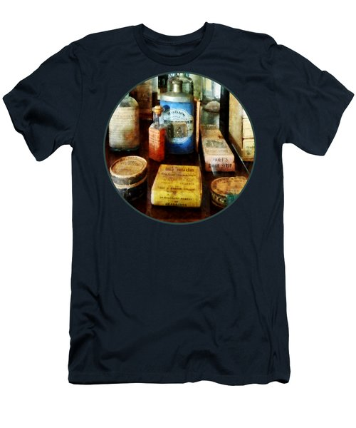 Men's T-Shirt (Slim Fit) featuring the photograph Pharmacy - Cough Remedies And Tooth Powder by Susan Savad