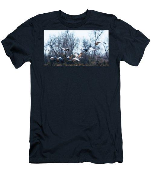 Sandhill Crane In Flight Men's T-Shirt (Slim Fit) by Edward Peterson