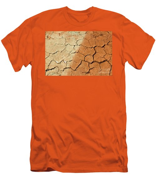 Men's T-Shirt (Slim Fit) featuring the photograph Cracked Soil In Red Shades by Les Palenik