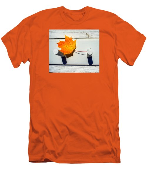 Men's T-Shirt (Slim Fit) featuring the photograph Autumn Leaf On Pegs by Gary Slawsky