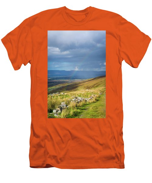 Men's T-Shirt (Slim Fit) featuring the photograph Sunshine And Raining Down With Rainbow On The Countryside In Ire by Semmick Photo