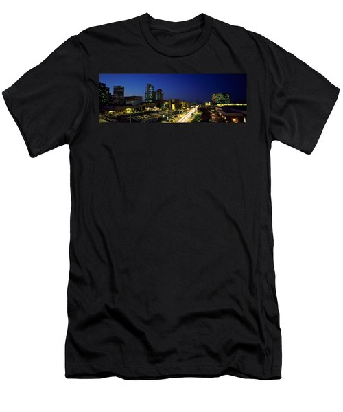 Buildings In A City Lit Up At Night Men's T-Shirt (Athletic Fit)