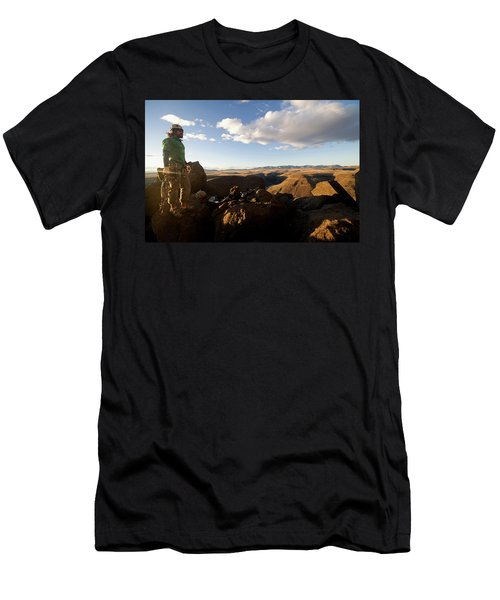 A Man Looking At A Rock Climbing Cliff Men's T-Shirt (Athletic Fit)
