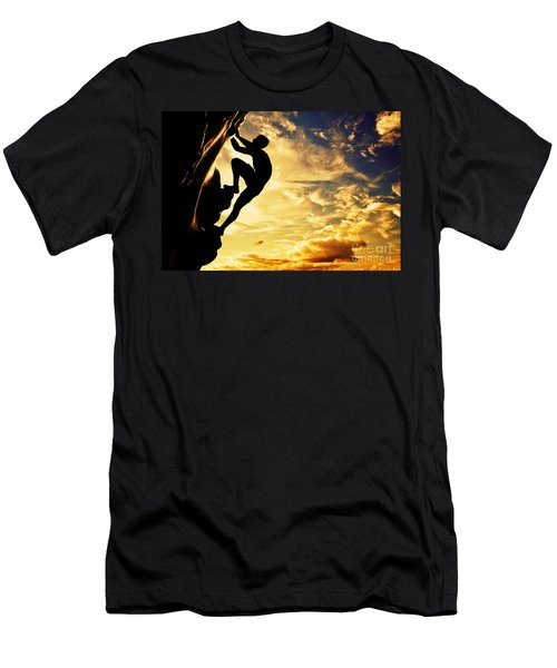 A Silhouette Of Man Free Climbing On Rock Mountain At Sunset Men's T-Shirt (Athletic Fit)