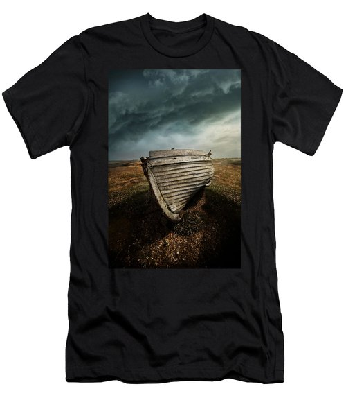 Men's T-Shirt (Athletic Fit) featuring the photograph An Old Wreck On The Field. Dramatic Sky In The Background by Jaroslaw Blaminsky