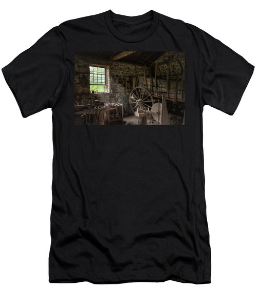Men's T-Shirt (Slim Fit) featuring the photograph Conestoga Wagon At The Blacksmith - Wagon Repair by Gary Heller
