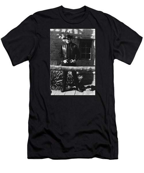 Men's T-Shirt (Slim Fit) featuring the photograph Johnny Cash Gunslinger Hitching Post Old Tucson Arizona 1971  by David Lee Guss
