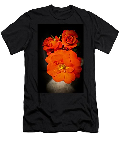 Men's T-Shirt (Slim Fit) featuring the photograph Orange Rose Trio by Joann Copeland-Paul