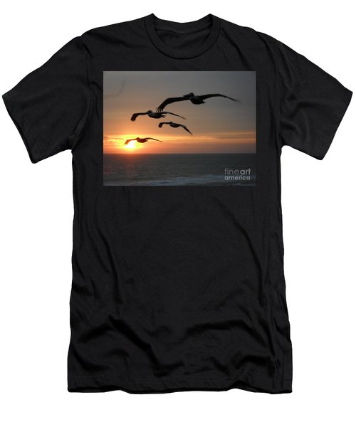 Men's T-Shirt (Athletic Fit) featuring the photograph Pelican Sun Up by Laurie Lundquist