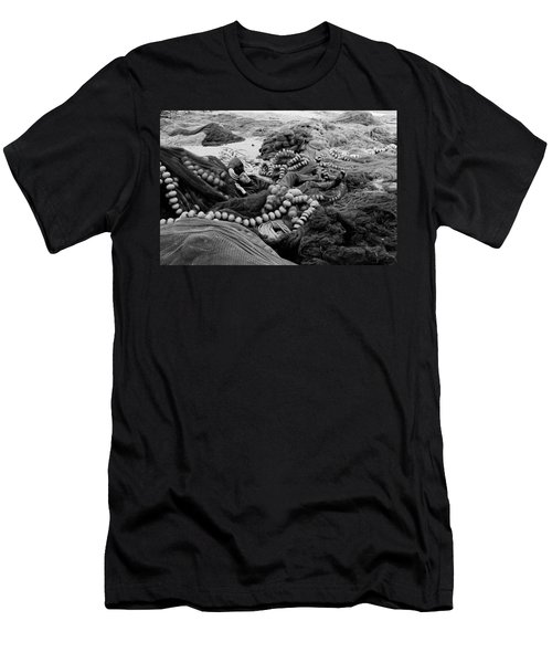 Men's T-Shirt (Slim Fit) featuring the photograph Fisherman Sleeping On A Huge Array Of Nets by Tom Wurl