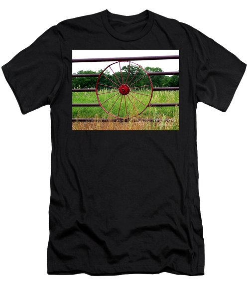Men's T-Shirt (Slim Fit) featuring the photograph Texas Wildflowers Through Wagon Wheel by Kathy  White