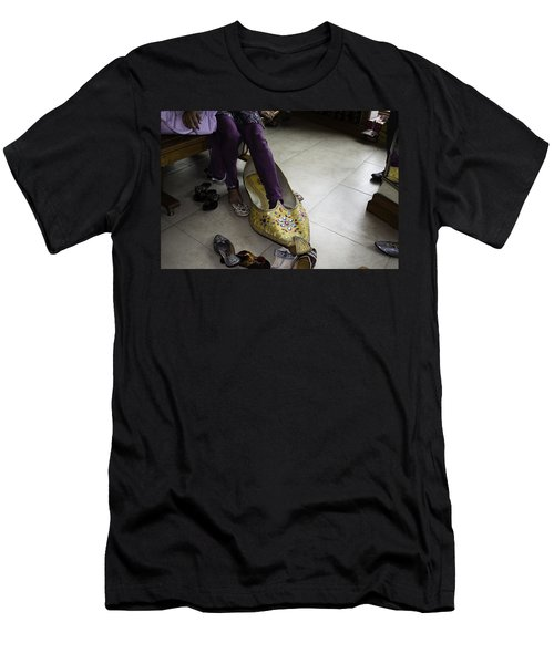 Trying On A Very Large Decorated Shoe Men's T-Shirt (Slim Fit) by Ashish Agarwal