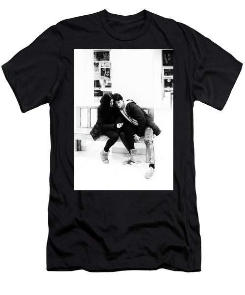 Men's T-Shirt (Athletic Fit) featuring the photograph Young Romantic Couple Sharing A Mobile Phone by John Williams