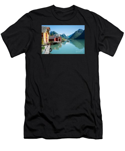 Men's T-Shirt (Athletic Fit) featuring the photograph Boathouse With Mountains And Reflection In The Fjord In Norway by IPics Photography