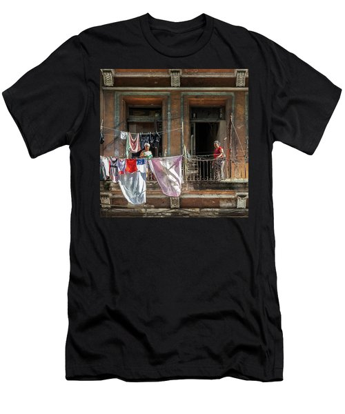 Men's T-Shirt (Slim Fit) featuring the photograph Cuban Women Hanging Laundry In Havana Cuba by Charles Harden