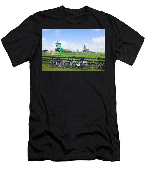 dutch windmills with bikes in Zaanse Schans Men's T-Shirt (Athletic Fit)