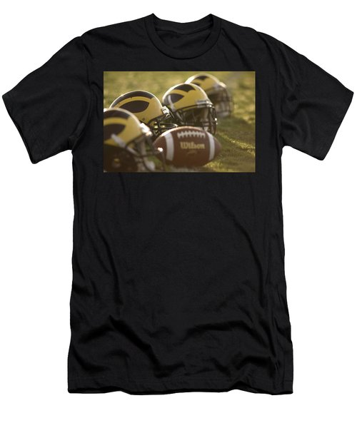 Helmets And A Football On The Field At Dawn Men's T-Shirt (Athletic Fit)