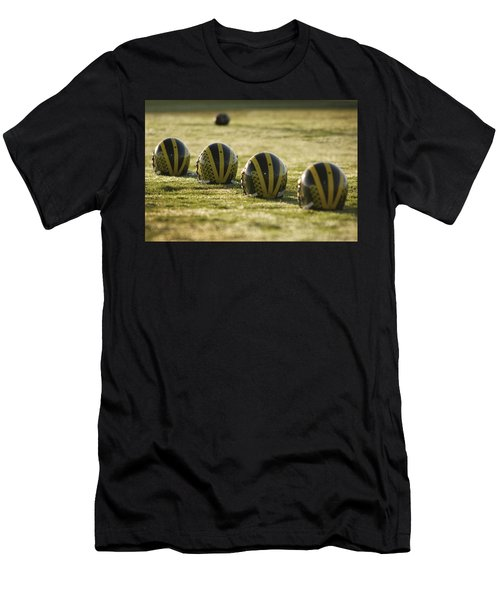 Helmets On Dew-covered Field At Dawn Men's T-Shirt (Athletic Fit)