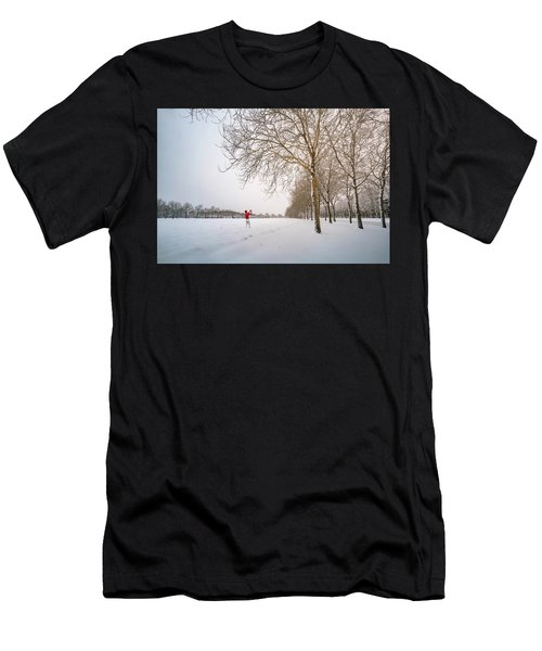 Man In Red Taking Picture Of Snowy Field And Trees Men's T-Shirt (Athletic Fit)