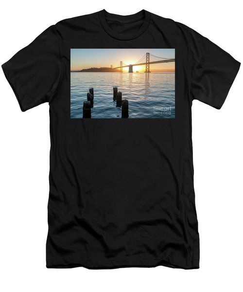Six Pillars Sticking Out The Water With Bay Bridge In The Backgr Men's T-Shirt (Athletic Fit)