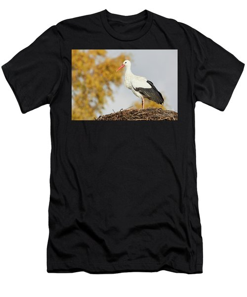 Men's T-Shirt (Athletic Fit) featuring the photograph Stork On A Nest, Trees In The Background by Nick Biemans
