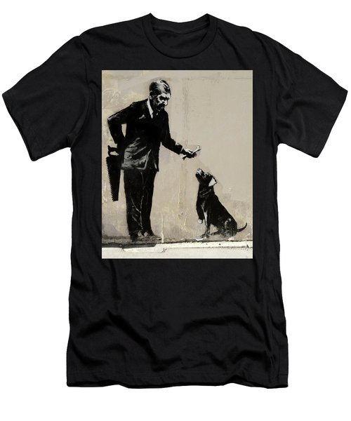 Men's T-Shirt (Athletic Fit) featuring the photograph Banksy Paris Man With Bone And Dog by Gigi Ebert