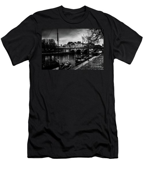 Men's T-Shirt (Athletic Fit) featuring the photograph Paris At Night - Seine River Towards Pont Neuf by Miles Whittingham