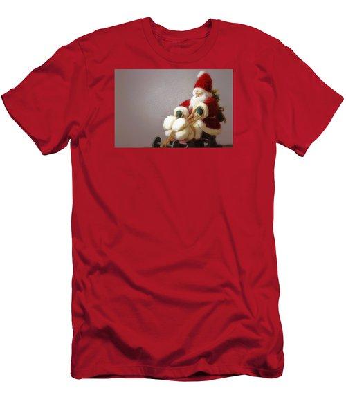 Santa Takes His Sled Men's T-Shirt (Slim Fit) by Nadalyn Larsen