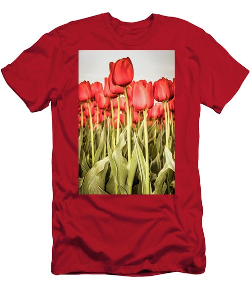 Men's T-Shirt (Athletic Fit) featuring the photograph Red Tulip Field In Portrait Format. by Anjo Ten Kate