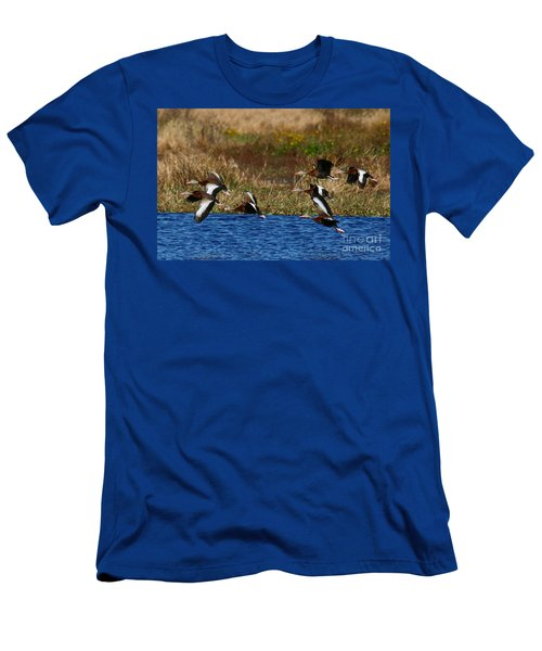 Men's T-Shirt (Slim Fit) featuring the photograph Flight Of The Whistlers by Myrna Bradshaw