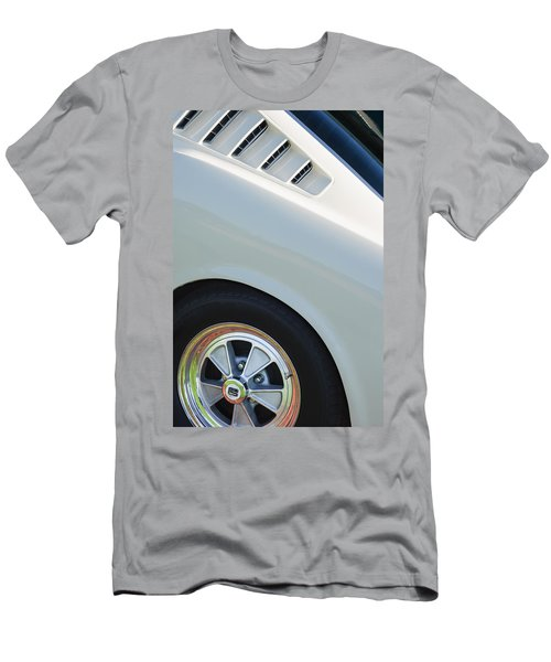 Men's T-Shirt (Athletic Fit) featuring the photograph 1965 Shelby Mustang Gt350 Wheel Emblem by Jill Reger