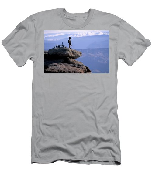 A Female Mountain Biker Stands Men's T-Shirt (Athletic Fit)