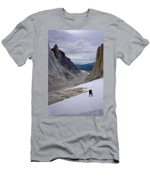 Climber On Snow With Huge Rock Spires Men's T-Shirt (Athletic Fit)