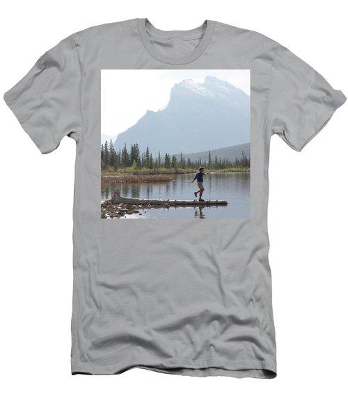 Man Balances Along Log Into Alpine Men's T-Shirt (Athletic Fit)