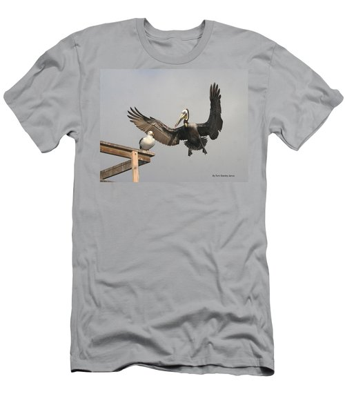 Men's T-Shirt (Slim Fit) featuring the photograph Pelican Wins Sea Gull Looses by Tom Janca