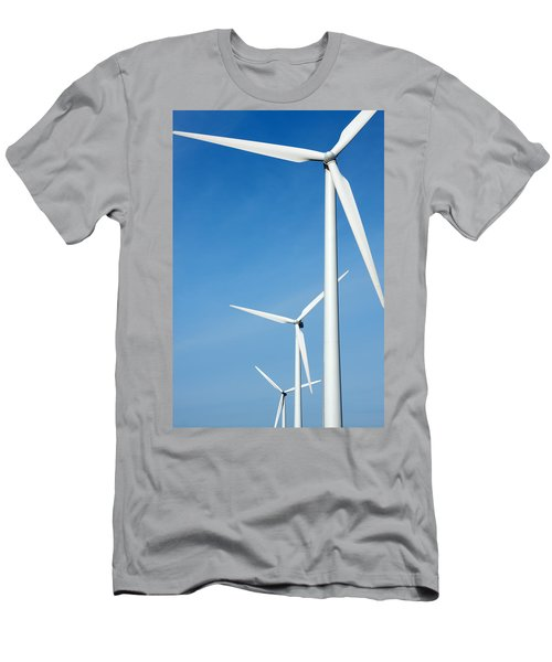Three Mighty Windmills In A Row Against A Blue Sky. Men's T-Shirt (Athletic Fit)