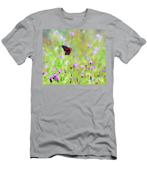 Men's T-Shirt (Athletic Fit) featuring the photograph Monarch Butterfly In Flight Over The Wildflowers by Kerri Farley