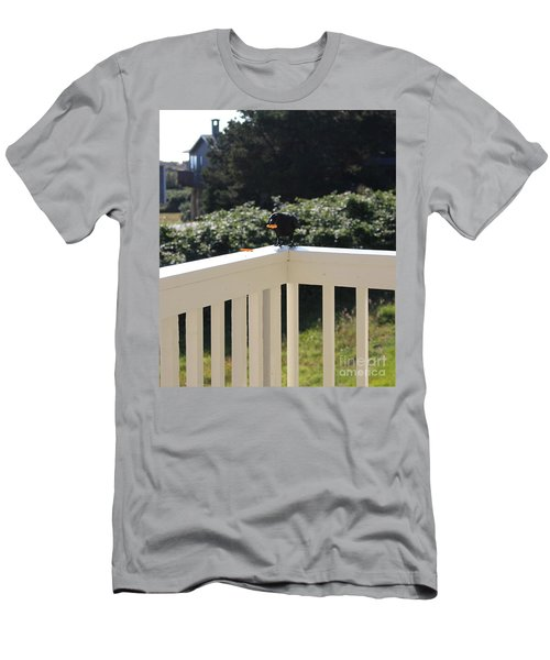 Men's T-Shirt (Athletic Fit) featuring the photograph One In The Mouth Is Worth by Marie Neder