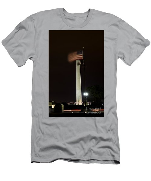 Men's T-Shirt (Athletic Fit) featuring the photograph Washington Monument At Night With Flag by Angela DeFrias