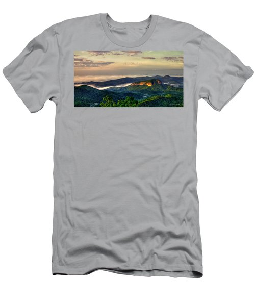 Men's T-Shirt (Athletic Fit) featuring the photograph Looking Glass Rock Sunrise Between The Clouds Blue Ridge Parkway by Reid Callaway