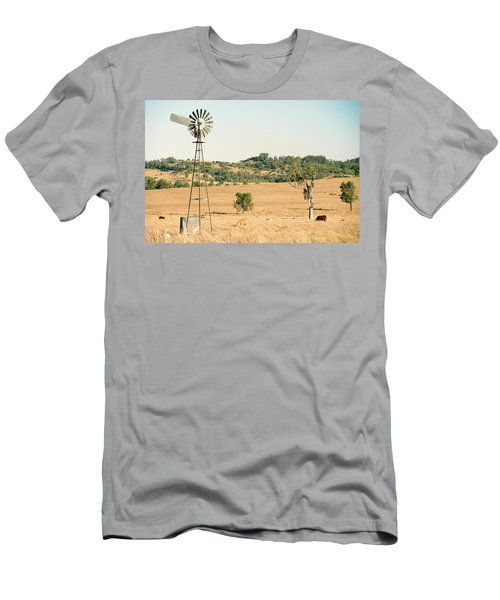 Men's T-Shirt (Athletic Fit) featuring the photograph Cows And A Windmill In The Countryside. by Rob D Imagery