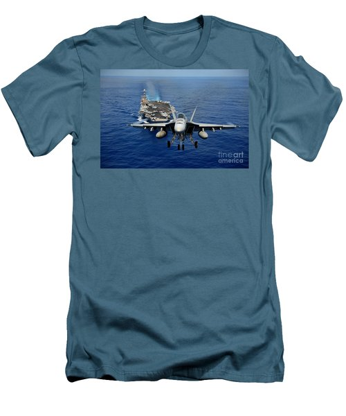 Men's T-Shirt (Slim Fit) featuring the photograph An Fa-18 Hornet Demonstrates Air Power. by Paul Fearn