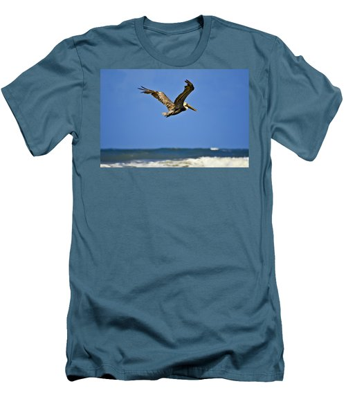 Men's T-Shirt (Slim Fit) featuring the photograph The Pelican And The Sea by DigiArt Diaries by Vicky B Fuller