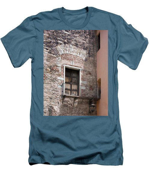 Men's T-Shirt (Slim Fit) featuring the photograph Weathered Wooden Church Doors by Lynn Palmer