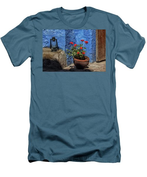 Men's T-Shirt (Slim Fit) featuring the photograph Red Geranium Near A Blue Wall by Patricia Hofmeester